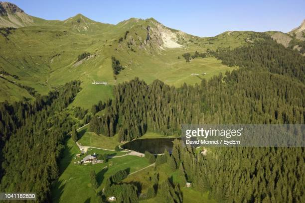 scenic view of landscape and mountains against sky - sallanches stock pictures, royalty-free photos & images