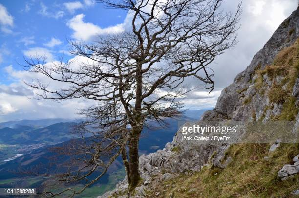scenic view of landscape and mountains against sky - iñaki mt stock photos and pictures