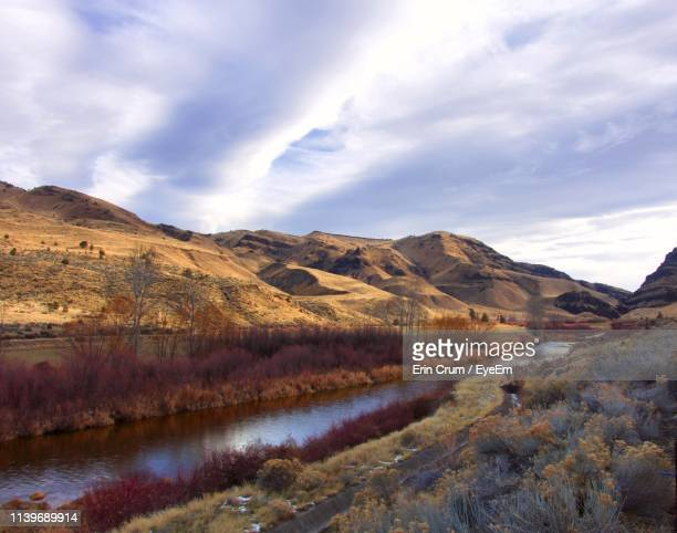 scenic view of landscape and mountains against sky - john day fossil beds national park stock pictures, royalty-free photos & images