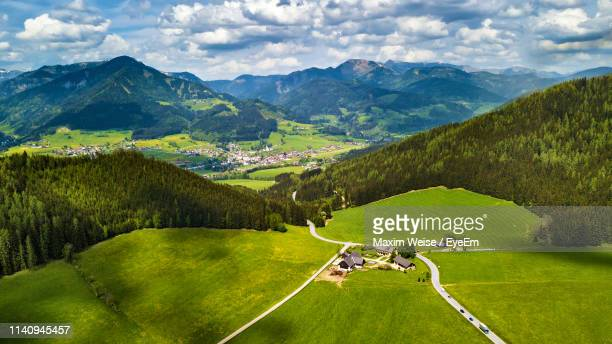 scenic view of landscape and mountains against sky - thal austria stock-fotos und bilder