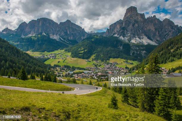 scenic view of landscape and mountains against sky - alta badia stock pictures, royalty-free photos & images
