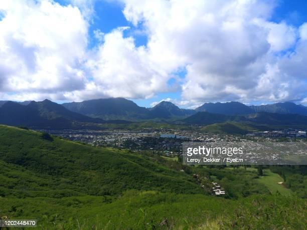 scenic view of landscape and mountains against sky - kailua stock pictures, royalty-free photos & images