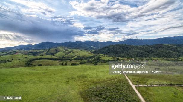 scenic view of landscape and mountains against sky - japonês stock pictures, royalty-free photos & images