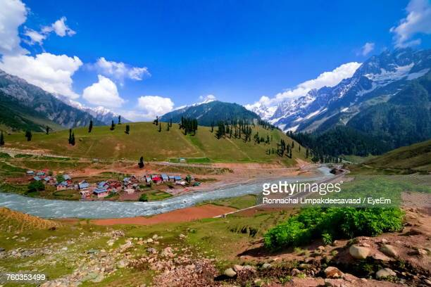 scenic view of landscape and mountains against sky - kashmir stock photos and pictures