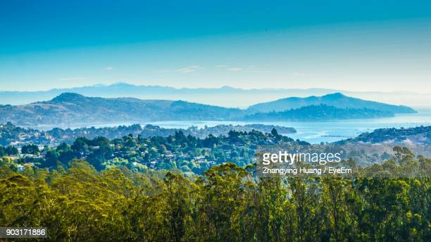 scenic view of landscape and mountains against sky - muir woods stock photos and pictures