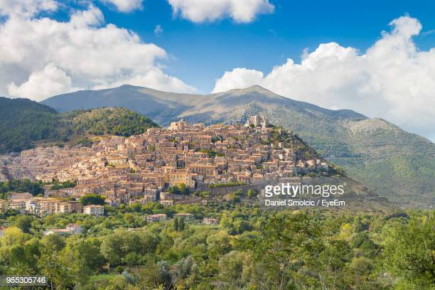 scenic view of landscape and mountains against sky - calabria stock pictures, royalty-free photos & images