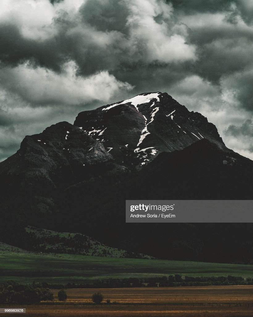 Scenic View Of Landscape And Mountains Against Sky : Stock Photo