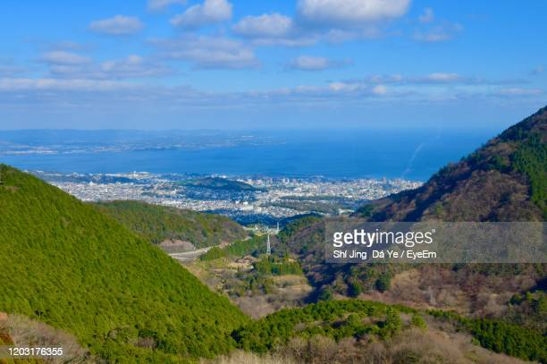 scenic view of landscape and sea against sky - 別府市 ストックフォトと画像