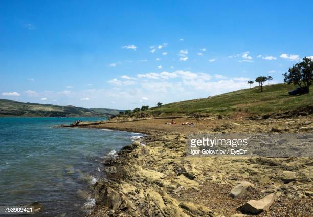 scenic view of landscape and sea against sky - igor golovniov stock pictures, royalty-free photos & images