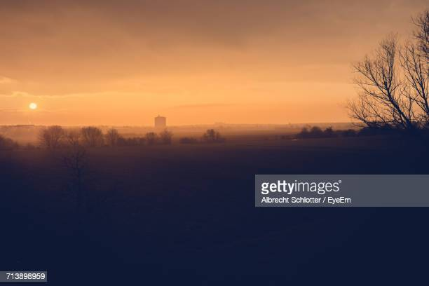 scenic view of landscape at sunset - albrecht schlotter foto e immagini stock