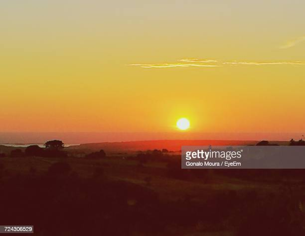 scenic view of landscape at sunset - moura stock photos and pictures