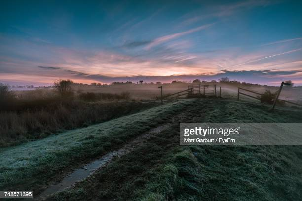 scenic view of landscape at sunset - suffolk england stock photos and pictures