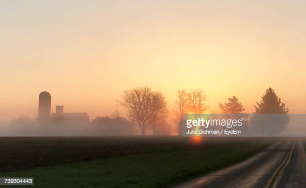 scenic view of landscape during foggy weather - indiana stock-fotos und bilder