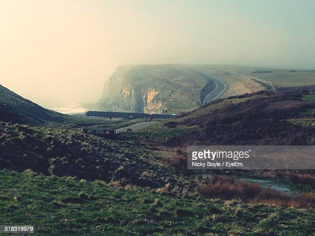 scenic view of landscape in fog - port talbot stock pictures, royalty-free photos & images