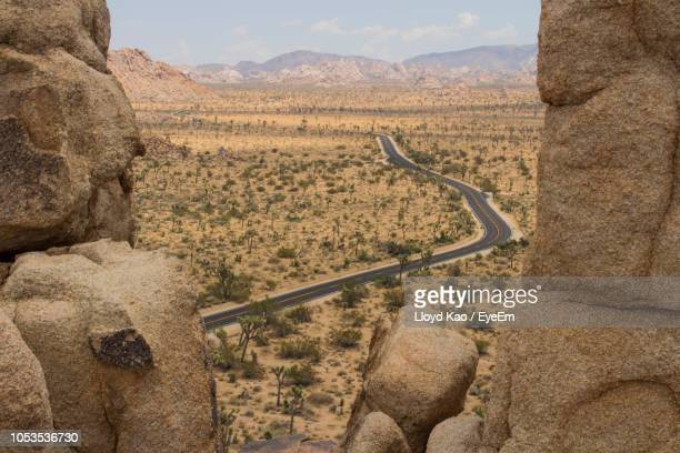 scenic view of landscape - joshua tree stock photos and pictures
