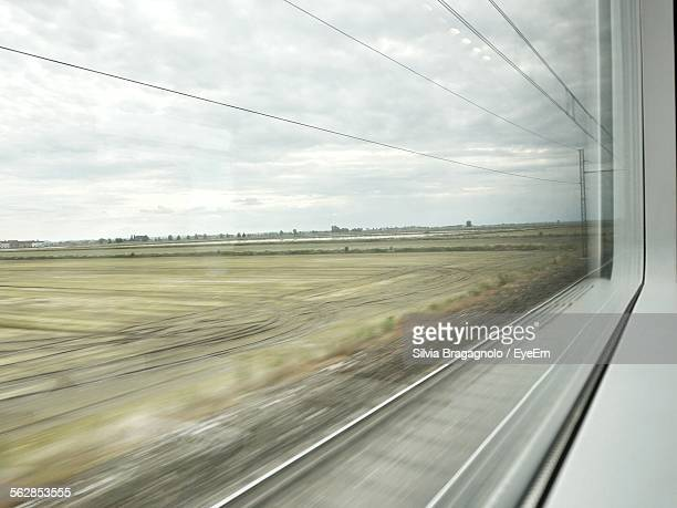 Scenic View Of Landscape Seen Through Train Window