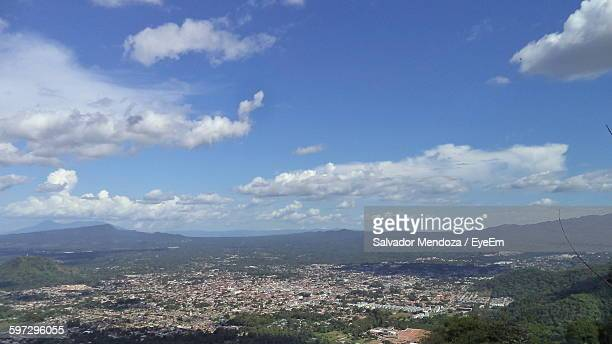 Scenic View Of Landscape With Cityscape Against Sky