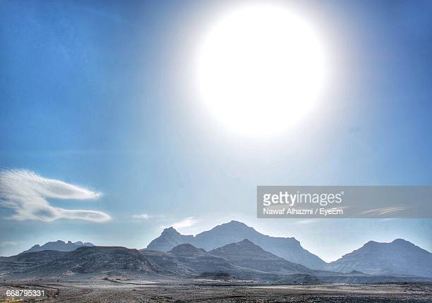 Scenic View Of Large Bright Sun Over Mountains
