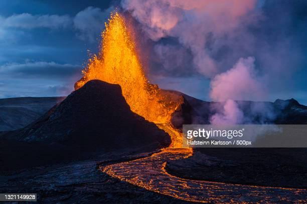 scenic view of lava against sky,grindavik,iceland - 噴出 ストックフォトと画像