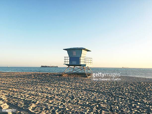 Scenic View Of Lifeguard Hut On Beach Against Clear Sky