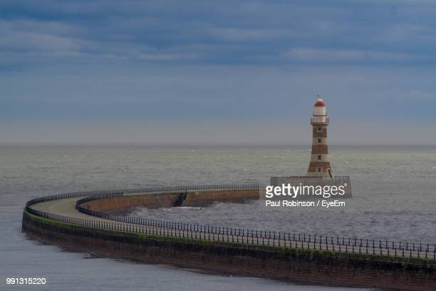 Scenic View Of Lighthouse By Sea Against Sky