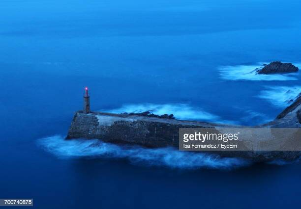 Scenic View Of Lighthouse By The Sea