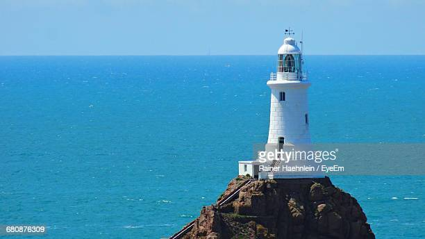Scenic View Of Lighthouse On Cliff