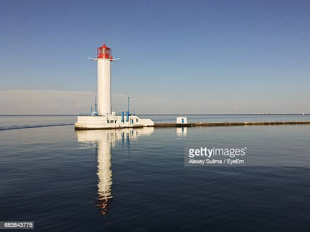 scenic view of lighthouse reflecting in sea - odessa ukraine stock photos and pictures