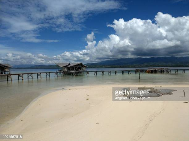 scenic view of love island beach against sky with clouds and wood and ocean - love island stock pictures, royalty-free photos & images