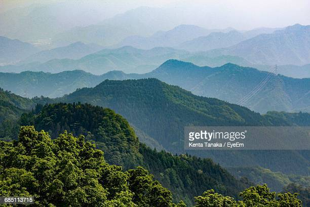 Scenic View Of Majestic Mountain Range In Summer