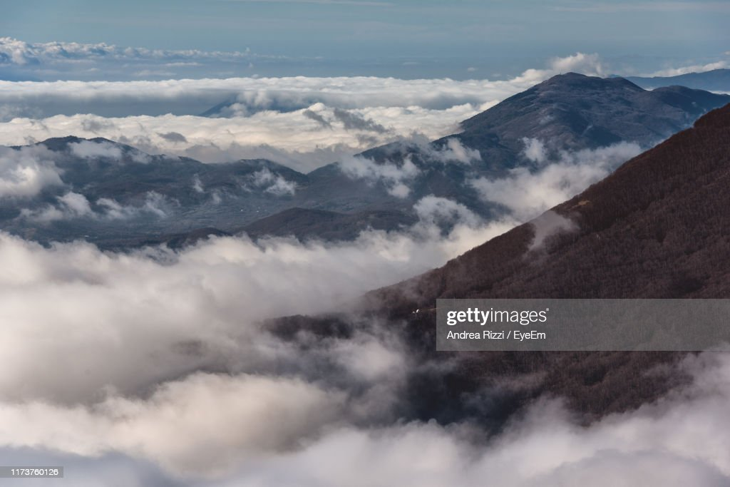 Scenic View Of Majestic Mountains Against Sky : Stock Photo