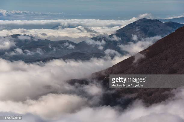 scenic view of majestic mountains against sky - andrea rizzi foto e immagini stock