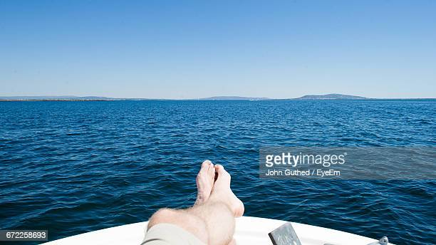 Scenic View Of Man Relaxing On Boat