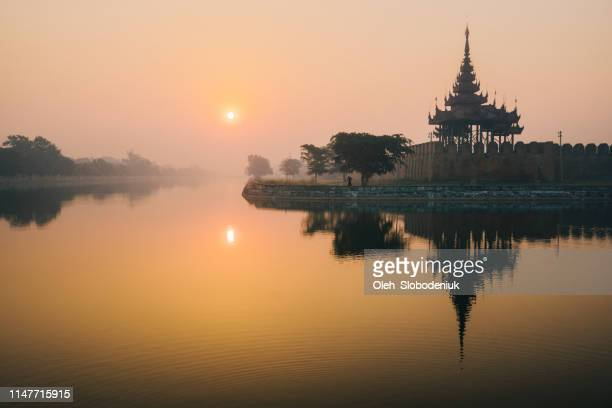 scenic view of mandalay city at sunset - myanmar culture stock pictures, royalty-free photos & images
