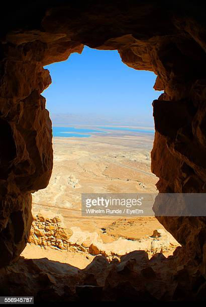 Scenic View Of Masada Seen Through Cave Window