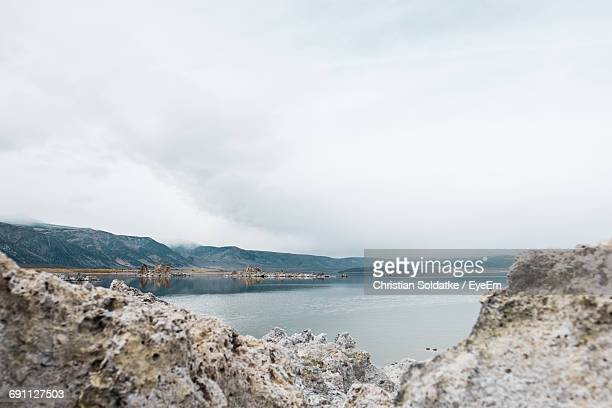scenic view of mono lake and mountains against sky - christian soldatke stock pictures, royalty-free photos & images