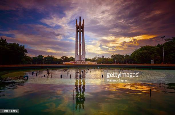 scenic view of monument by park against sky in city - philippines flag stock pictures, royalty-free photos & images