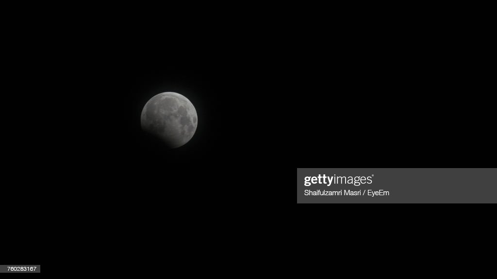 Scenic View Of Moon Against Clear Sky At Night : Stock Photo