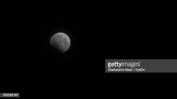 scenic view of moon against clear sky at night - shaifulzamri stock pictures, royalty-free photos & images