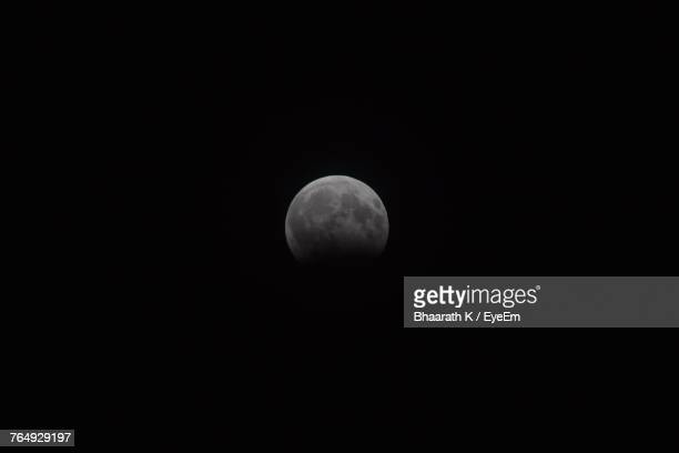 Scenic View Of Moon Against Clear Sky At Night