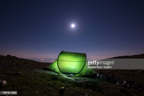 scenic view of moon against sky at night - andrea rizzi stockfoto's en -beelden