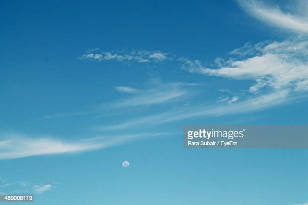 Scenic view of moon in blue sky