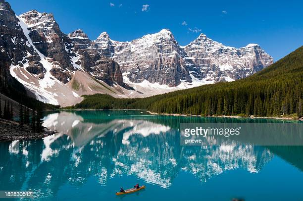 scenic view of moraine lake on a summer day - moraine lake stock pictures, royalty-free photos & images