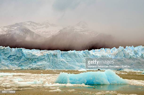 Scenic View Of Moreno Glacier By Snowcapped Mountain