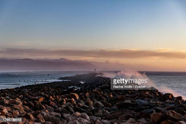 scenic view of morro bay breakers at sunset. - rachel wolfe stock pictures, royalty-free photos & images