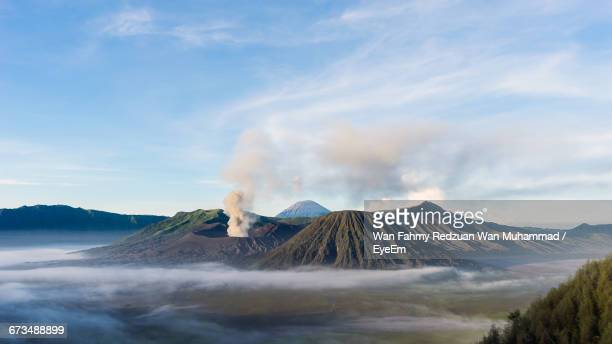 scenic view of mount bromo against sky - mt bromo stock photos and pictures