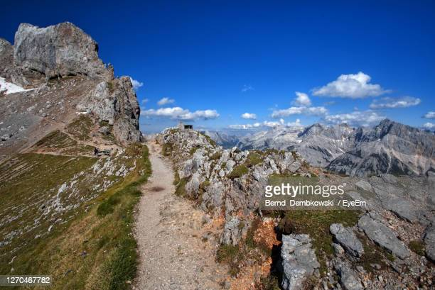 scenic view of mountain against blue sky - mittenwald stock pictures, royalty-free photos & images