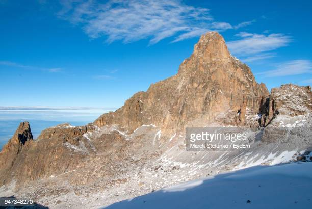 scenic view of mountain against blue sky - marek stefunko stock photos and pictures