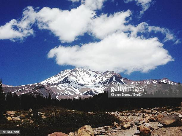 scenic view of mountain against cloudy sky - mt shasta stock pictures, royalty-free photos & images