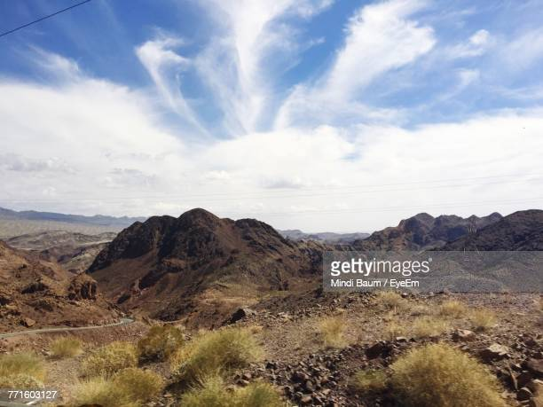 scenic view of mountain against cloudy sky - baum stock pictures, royalty-free photos & images